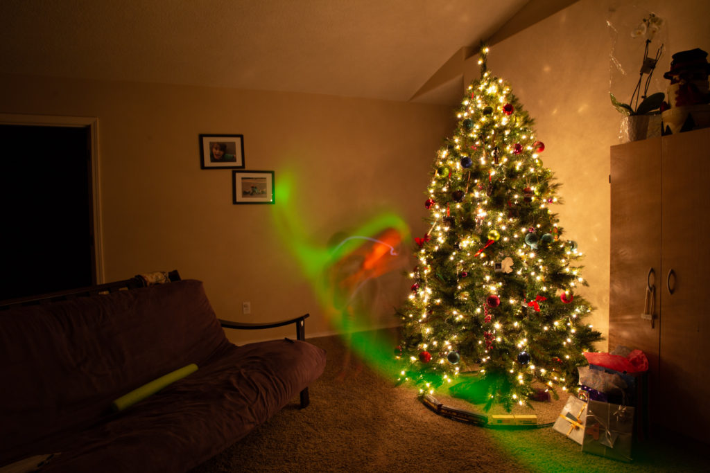 "Long exposure with my niece and nephew ""painting light"" at Christmas. Photo by Shane Cotee."